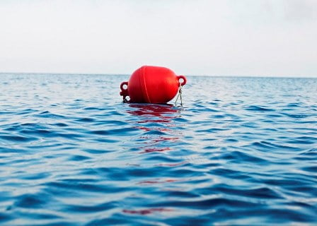 Red Buoy And Sea